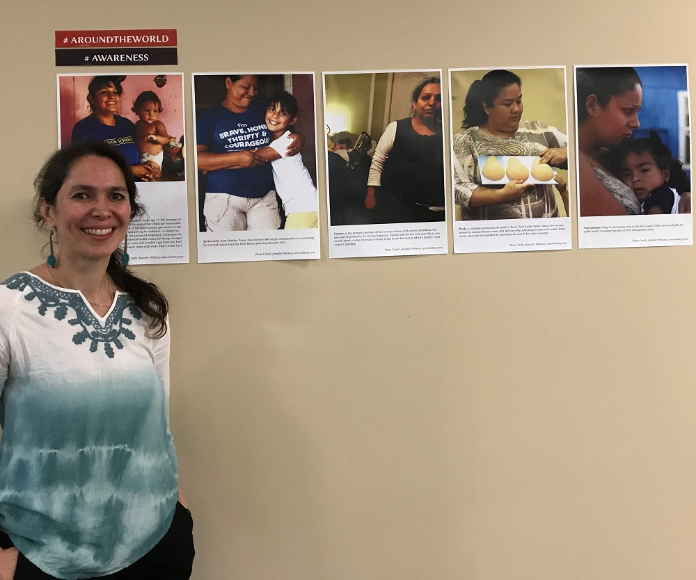 Cyntia Barzelatto with reproductive justice posters at JF&CS.