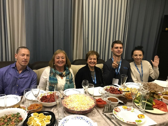 Lauren & Mark Rubin Visiting Moms at a dinner in Dnipro.