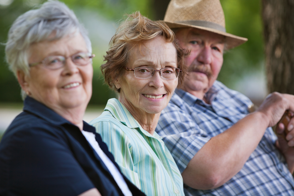 A group of older adults enjoying being outside.