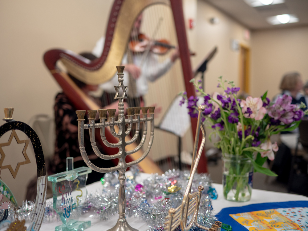 A menorah and music at the Family Table Chanukkah Celebration.