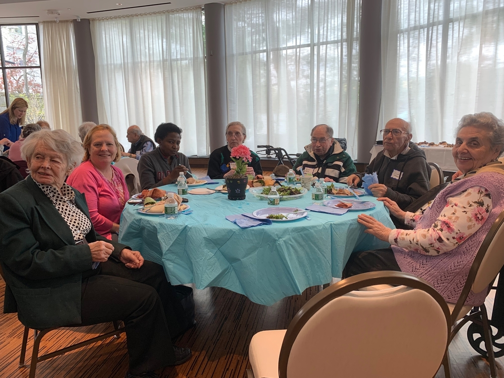 A table of guests at the 2019 Yom HaShoah luncheon organized by Cafe Hakalah.