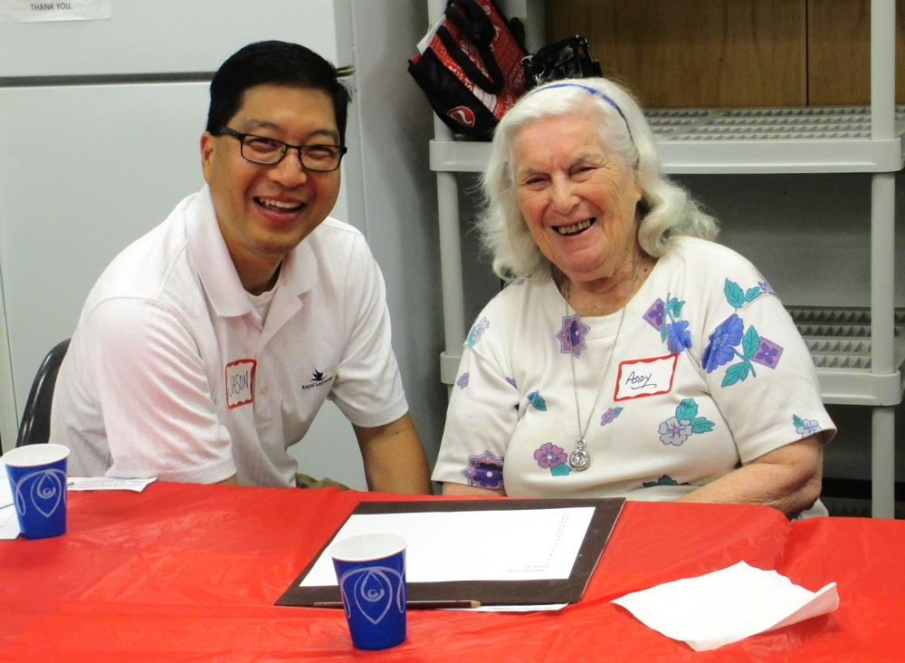 A volunteer and a guest at a memory cafe.