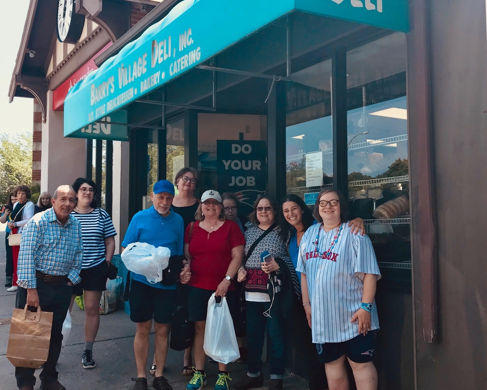 Chaverim Shel Shalom participants in front of Barry's Village Deli.